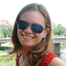 Image of Sara Sizemore, presenting as a white female with long, light brown hair. She is wearing sunglasses and smiling.